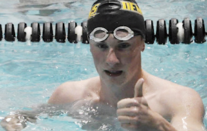 Healy rewrites swimming recordbook at brother's expense