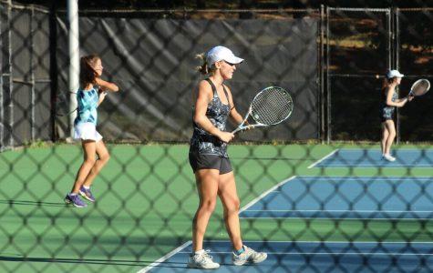 Senior Charlotte Ririe serves as varsity women's tennis team co-captain